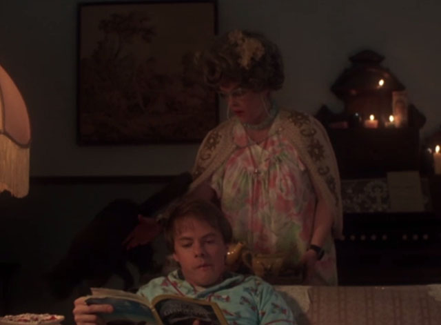 976-EVIL - Aunt Lucy Sandy Dennis pushing cat off couch with Hoax Stephen Geoffreys