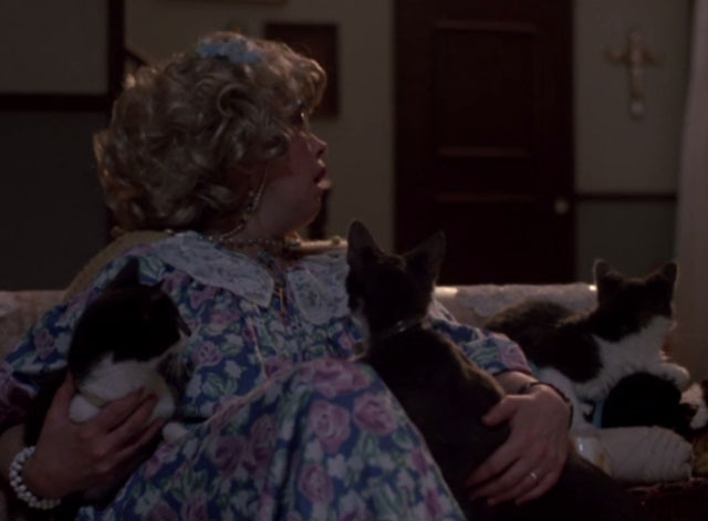 976-EVIL - Aunt Lucy Sandy Dennis sitting on couch with several cats, all looking at door