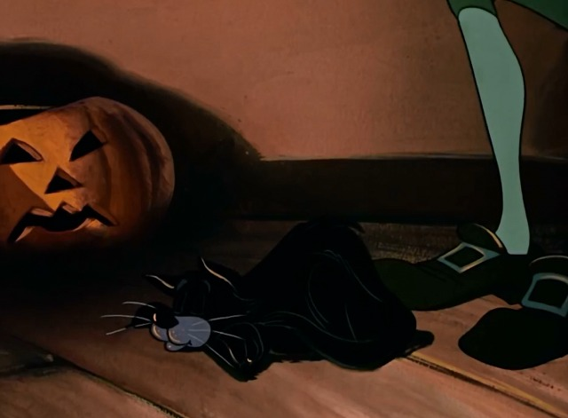 The Adventures of Ichabod and Mr. Toad - black cat sleeping at Ichabod Crane's feet