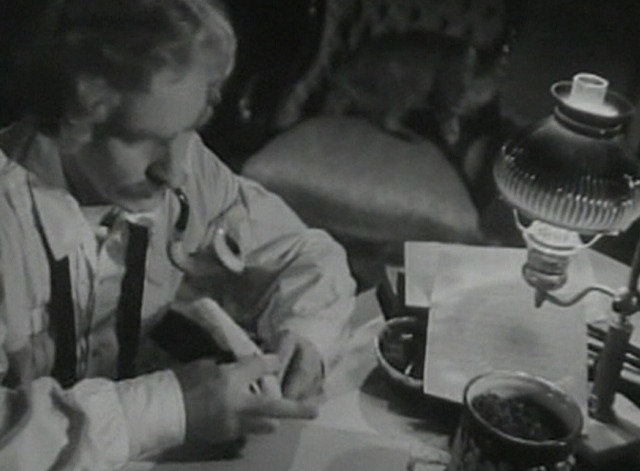 The Adventures of Mark Twain - Mark Twain with tabby cat on chair in background