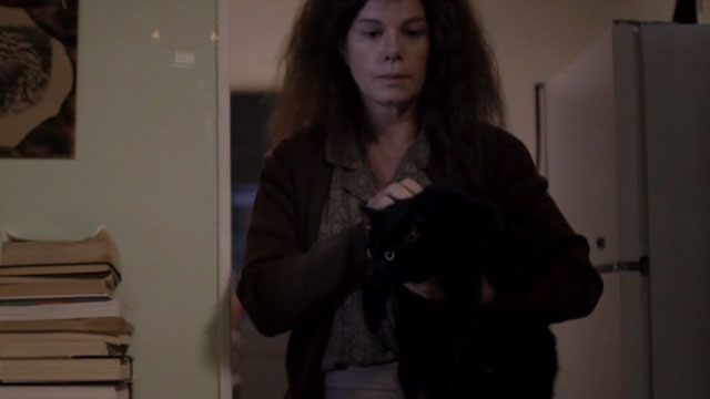 After Words - Jane Marcia Gay Harden holding black cat