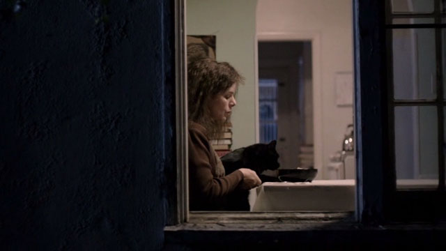 After Words - Jane Marcia Gay Harden sitting at kitchen table with black cat