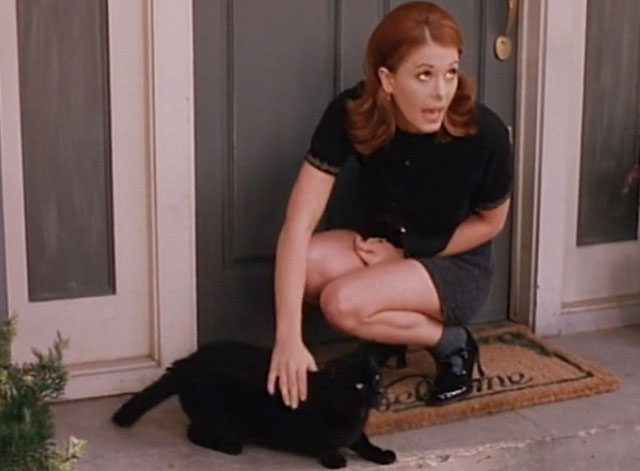 Amanda & the Alien - Amanda Nicole Eggert petting black cat on front step