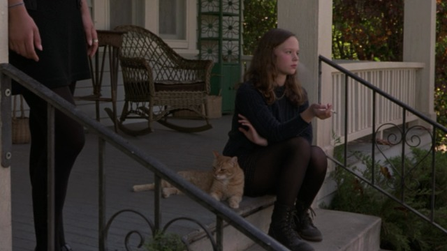 Anywhere But Here - orange tabby cat sitting on porch with Mary