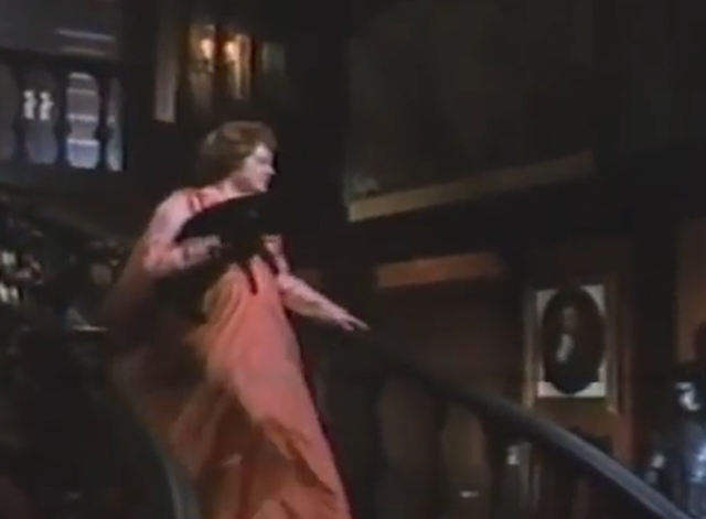 Arnold - Hester Elsa Lanchester carrying black cat down stairs