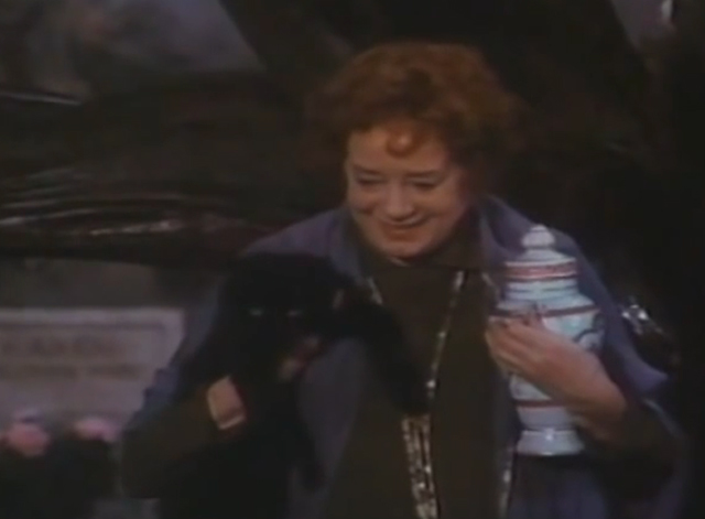 Arnold - Hester Elsa Lanchester holding black cat and urn