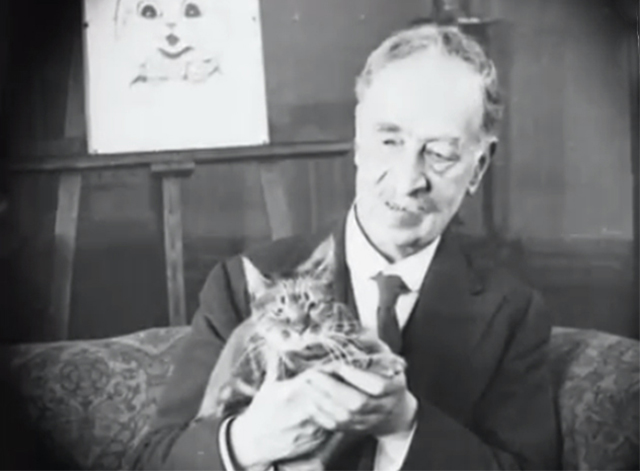 Art Celebrities at Home - Louis Wain holding tabby cat