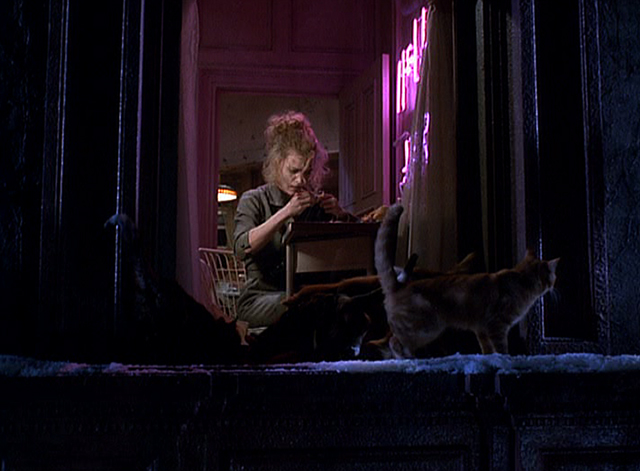 Batman Returns - cats gather around window as Selina Michelle Pfeiffer sews outfit apartment