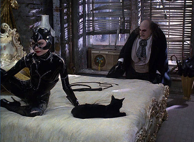 Batman Returns - Catwoman Michelle Pfeiffer with Penguin Danny DeVito and black cat on bed