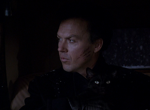 Batman Returns - Bruce Wayne Michael Keaton holding black cat in back of car