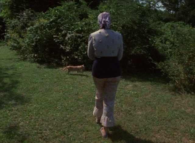 The Beales of Grey Gardens - tabby cat Pinky out in yard with Edie