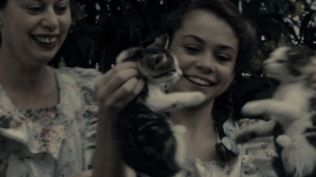 Because I Said So - home movie footage of woman and girl who is holding up two kittens by the scruff