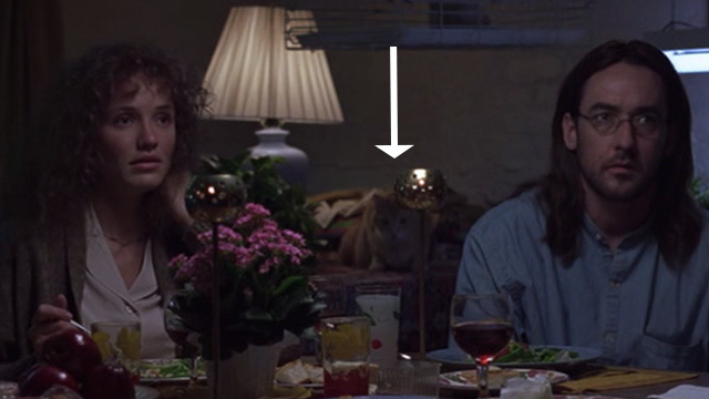 Being John Malkovich - cat in background behind Craig John Cusack and Lotte Cameron Diaz
