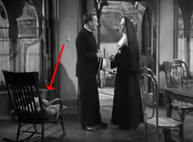 The Bells of St. Mary's - kitten on chair behind Father O'Malley Bing Crosby