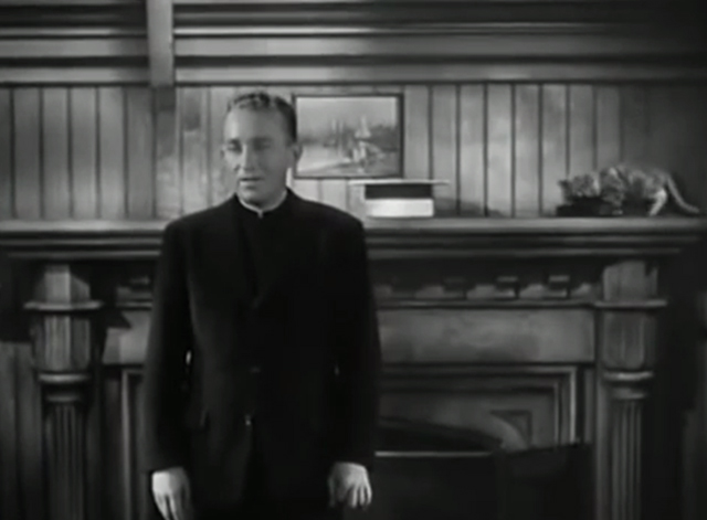 The Bells of St. Mary's - kitten on shelf behind Father O'Malley Bing Crosby