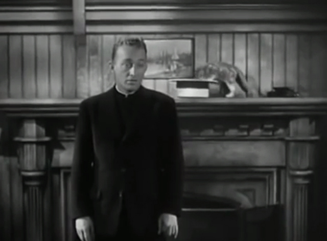 The Bells of St. Mary's - kitten on shelf with head in straw hat behind Father O'Malley Bing Crosby
