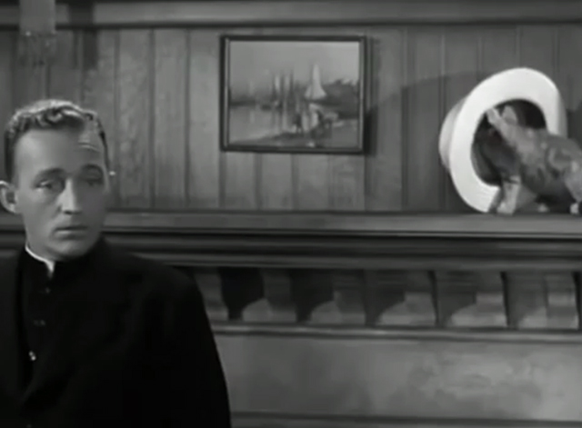 The Bells of St. Mary's - kitten playing with straw hat on shelf behind Father O'Malley Bing Crosby