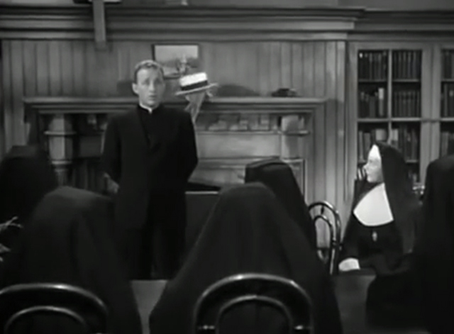 The Bells of St. Mary's - kitten almost falling off shelf behind Father O'Malley Bing Crosby