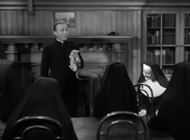 The Bells of St. Mary's - kitten being held by Father O'Malley Bing Crosby