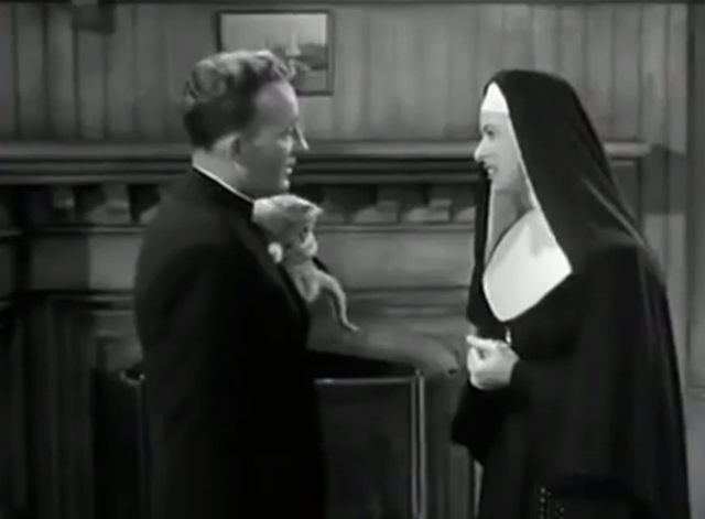 The Bells of St. Mary's - kitten being held by Father O'Malley Bing Crosby with Sister Benedict Ingrid Bergman