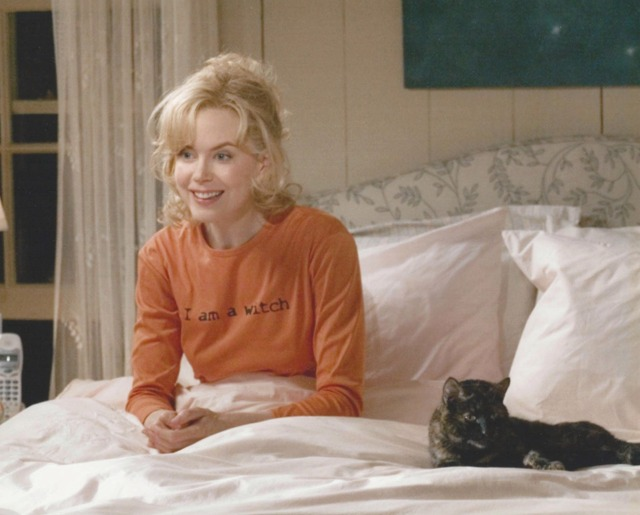 Bewitched - Isabel Nicole Kidman on bed with Lucinda tortoiseshell cat