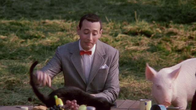 Big Top Pee-Wee - black cat on table with pig and Pee Wee-Herman