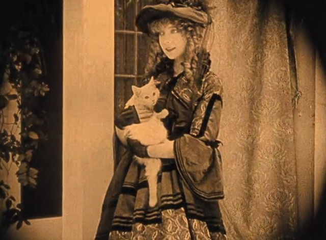 The Birth of a Nation - Elsie Lillian Gish holding white long-haired cat on porch