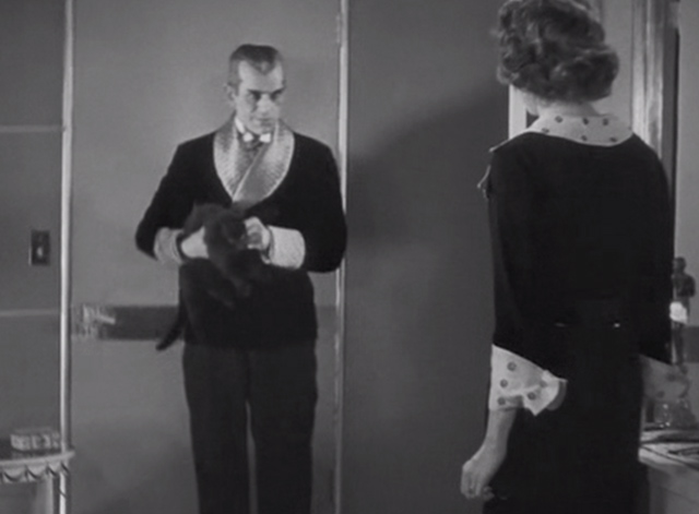 The Black Cat 1934 - Poelzig Boris Karloff holding black cat while looking at Joan Julie Bishop
