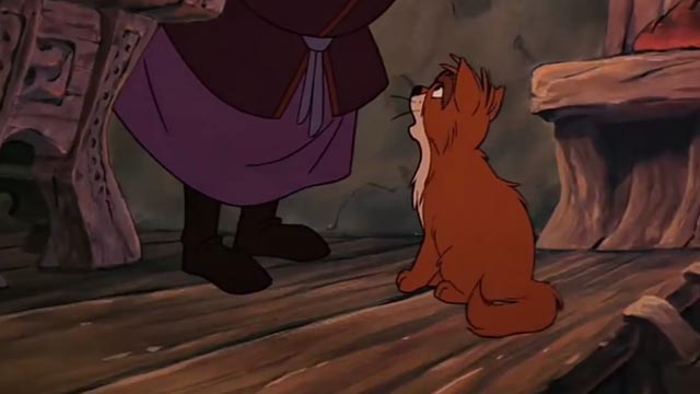 The Black Cauldron - orange and white Cat at Dallbin's feet