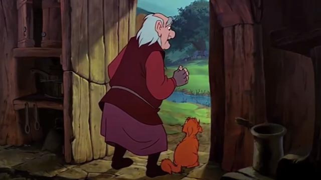 The Black Cauldron - orange and white Cat sitting beside Dallbin in doorway