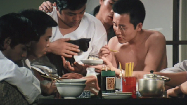 Bloody Territories - Oonogi clan members trying to feed rice to black kitten