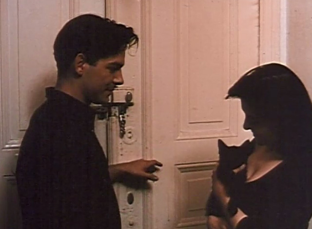 The Blue Hour - Theo Andreas Herder with Marie Dina Leipzig holding black kitten