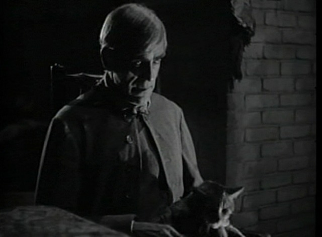 The Body Snatcher - John Gray looking scary with tabby cat Brother on lap