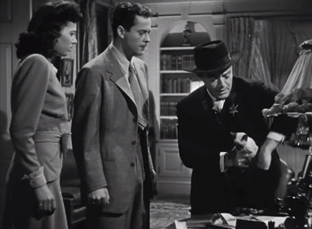 The Boogie Man Will Get You - Dr. Arthur Lorencz Peter Lorre placing Siamese kitten in pocket with Winnie Jeff Donnell and Bill Larry Parks