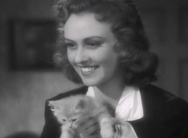Broadway Musketeers - Isabel Margaret Lindsay holding small ginger tabby kitten