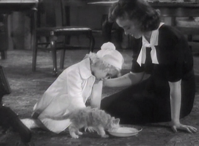 Broadway Musketeers - Isabel Margaret Lindsay and Judy Janet Chapman feeding small ginger tabby kitten from bowl on floor