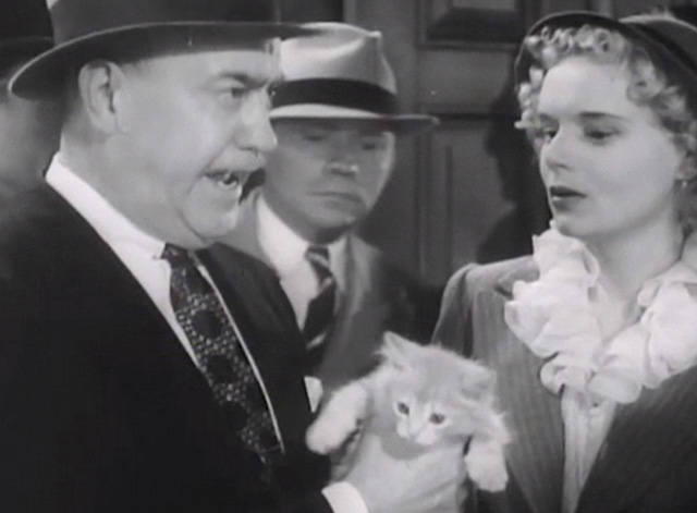 Broadway Musketeers - police inspector holding small ginger tabby kitten