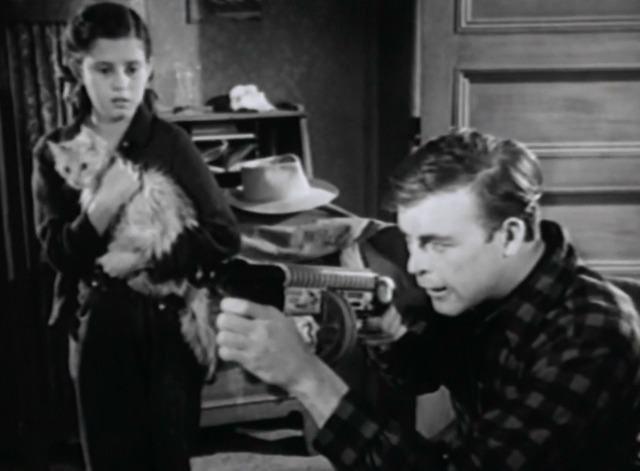 Canon City - girl Myrna holding nervous cat while Scott Brady fires toy gun