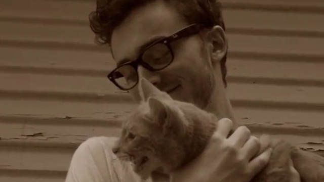 Cat - Daniel Michael Gerstein holding orange tabby cat Lloyd
