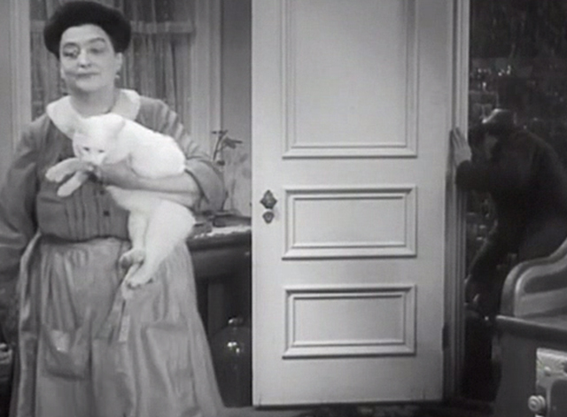 Chasing Yesterday - Therese Helen Westley turning away from door with white cat Whitey