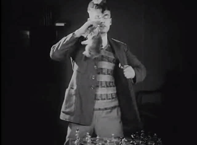 Chess Fever - Vladimir Fogel pulling kitten from breast pocket