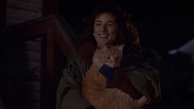 Children of a Lesser God - Sarah Marlee Martlin holding orange tabby cat while standing