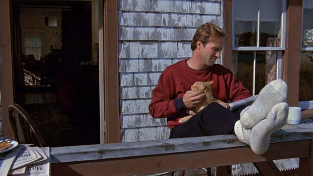 Children of a Lesser God - James William Hurt with orange tabby cat on lap on porch