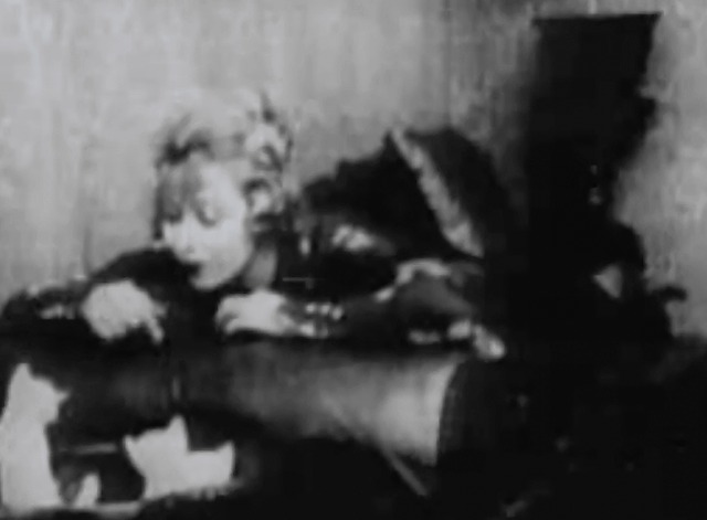 A Clever Dummy - Claire Anderson playing with kittens