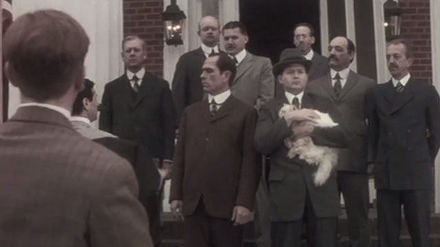 Cobb - Ty Cobb Tommy Lee Jones standing on steps with Calvin Coolidge and long-haired cream Persian