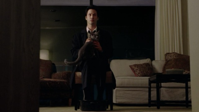 Constantine - Constantine Keanu Reeves sitting with Russian Blue cat Duck meowing on lap