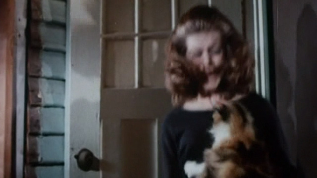 The Corpse Grinders - long-haired calico cat attacking woman