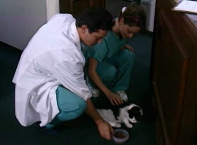 The Corpse Grinders 2 - Nurse Angie Cara Jo Basso feeding tuxedo cat Kitty with Dr. Glass Paul MacDonald
