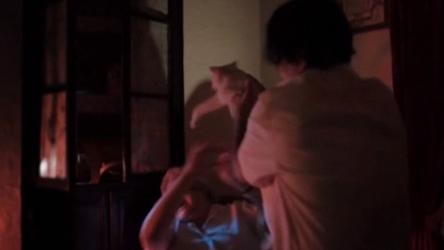 The Corpse Grinders 2 - Arnie's mother being attacked by white cat Mr. Beasley the Second