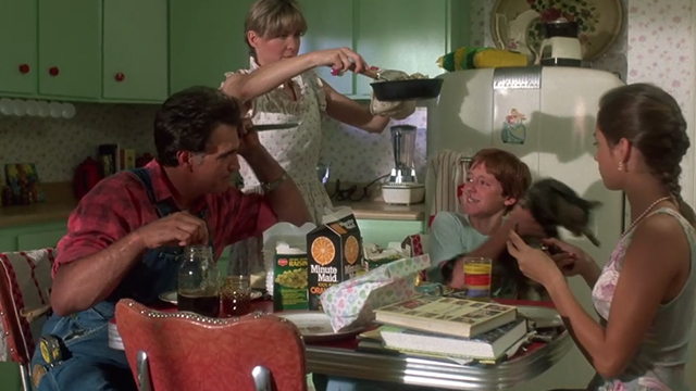 Critters - Brad Scott Grimes setting down Bengal tabby cat Chewie with Brown family eating Billy Green Bush Dee Wallace Stone and Nadine Van Der Velde